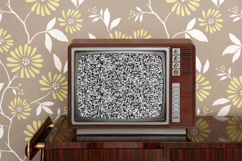 Retro houten TV op het houten meubilair van vitagejaren '60 stock afbeelding