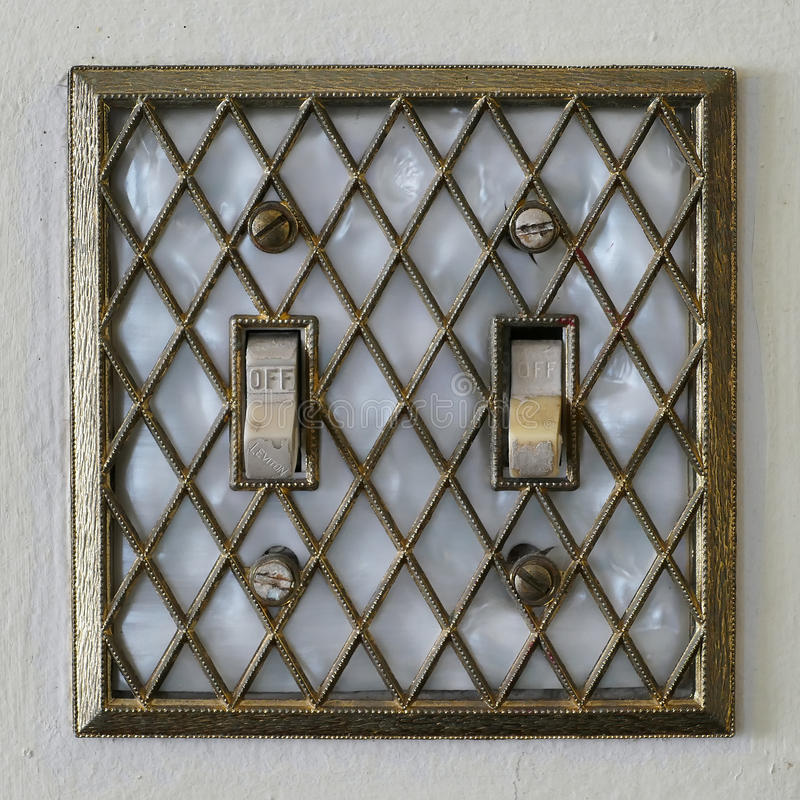 Retro- im altem Stil Lightswitch lizenzfreies stockfoto