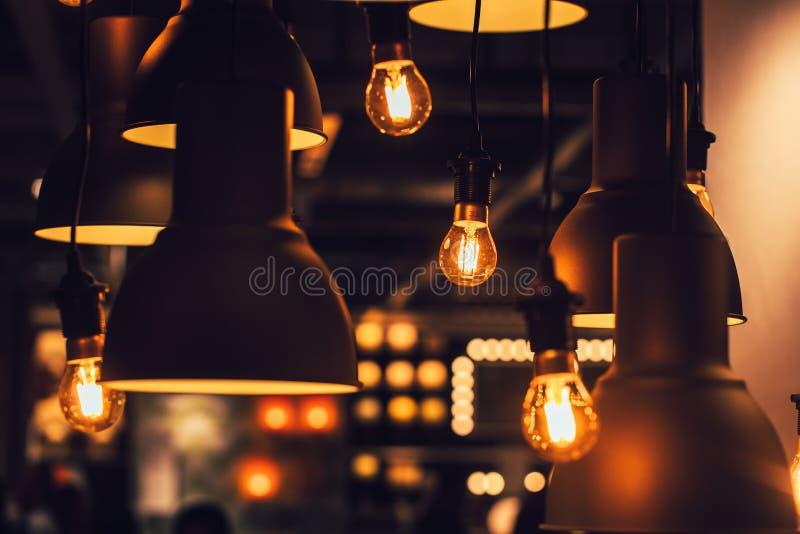 Retro industrial loft style hanging tungsten lamp bulb decoration stock photo