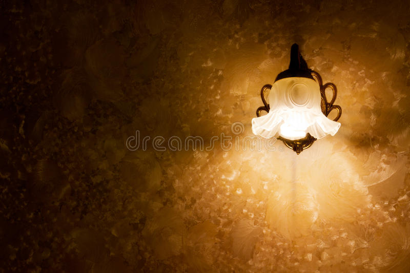 Retro lamp. Wall lamp on textured wallpaper stock images