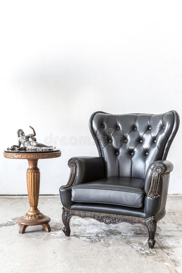 Retro leather chair with cabinet stock photography