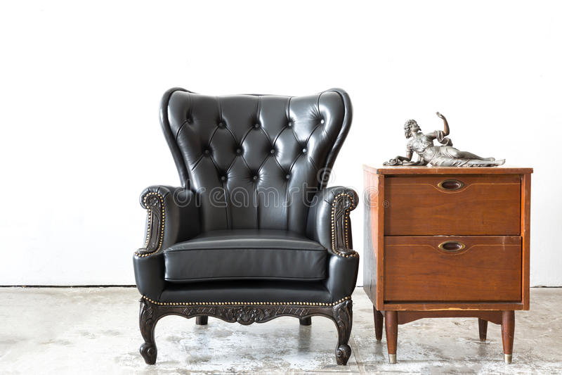 Retro leather chair with cabinet stock photo