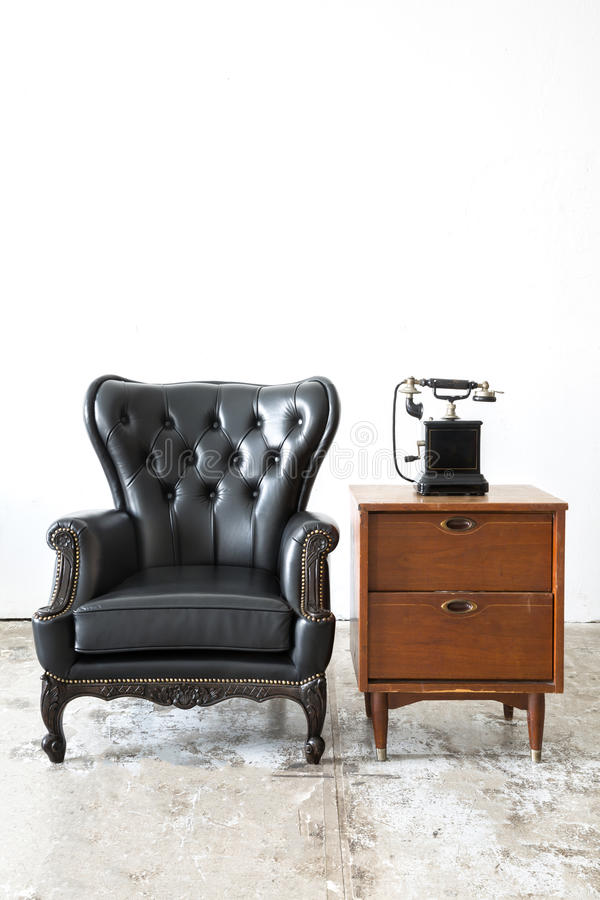 Retro leather chair with telephone stock images