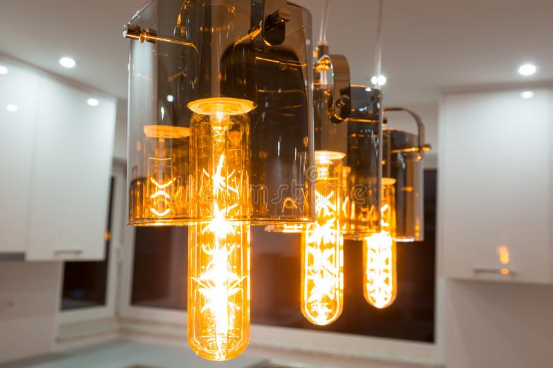 Retro light bulbs in glass lamps royalty free stock image