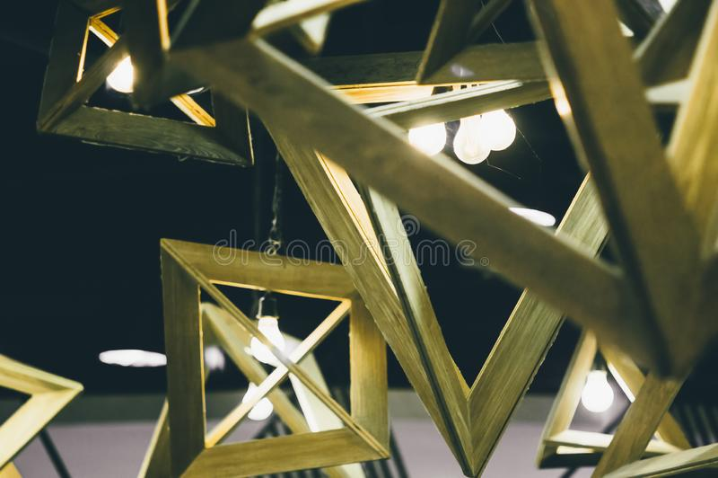 Retro light bulbs hanging in department store, with decorate interior luxury, fixtures combine beautiful modernity Designer, lamps. On the ceiling, beautifully royalty free stock photo