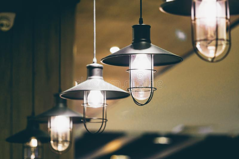 Retro light bulbs hanging in department store, with decorate interior luxury, fixtures combine beautiful modernity Designer, lamps. On the ceiling, beautifully royalty free stock image