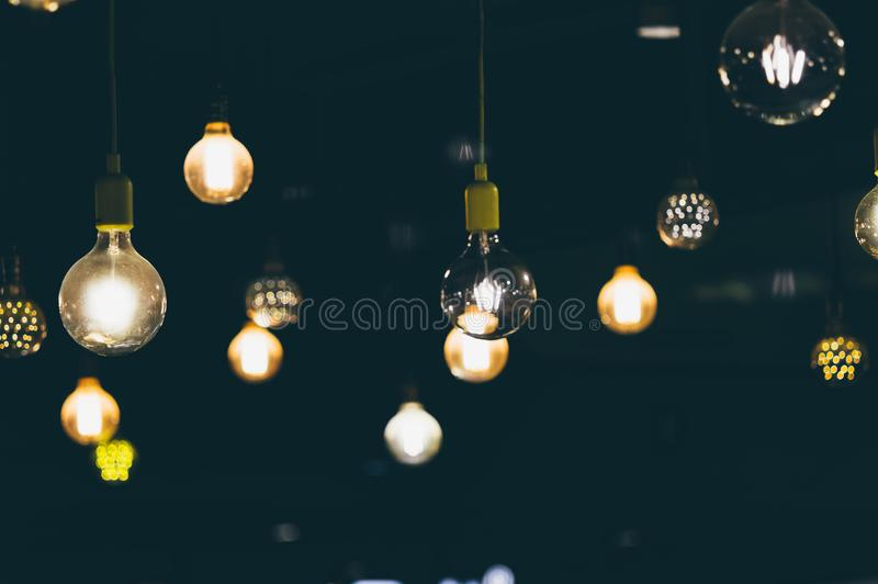 Retro light bulbs hanging in department store, with decorate interior luxury, fixtures combine beautiful modernity Designer, lamps. On the ceiling, beautifully stock photos