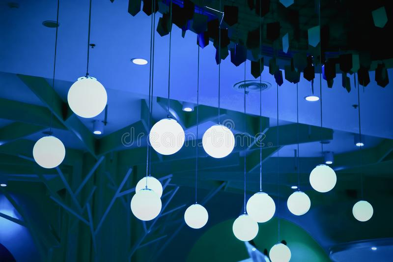 Retro light bulbs hanging in department store, with decorate interior luxury, fixtures combine beautiful modernity Designer, lamps. On the ceiling, beautifully royalty free stock photos