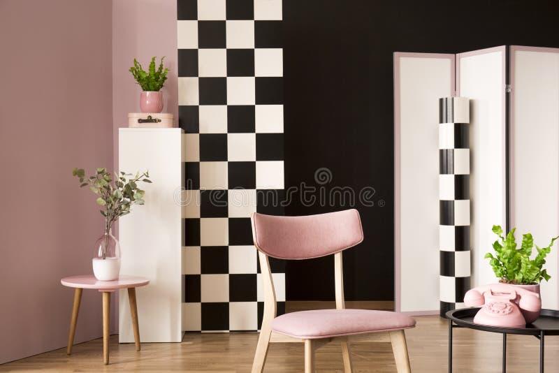 retro living room interior pink chair coffee table phone plants checkered wallpaper retro living room 116943998
