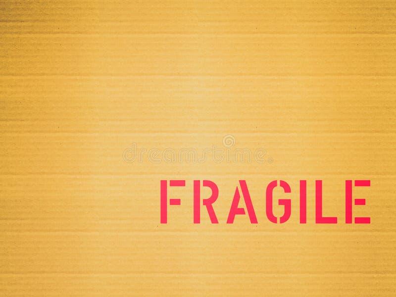 Retro look Fragile corrugated cardboard. Vintage looking A picture of Corrugated cardboard with fragile label stock image