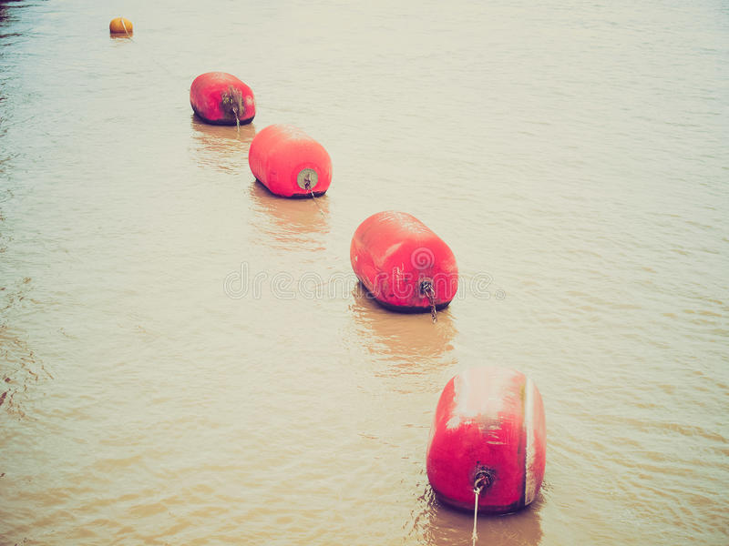 Retro look Life buoy in water royalty free stock images