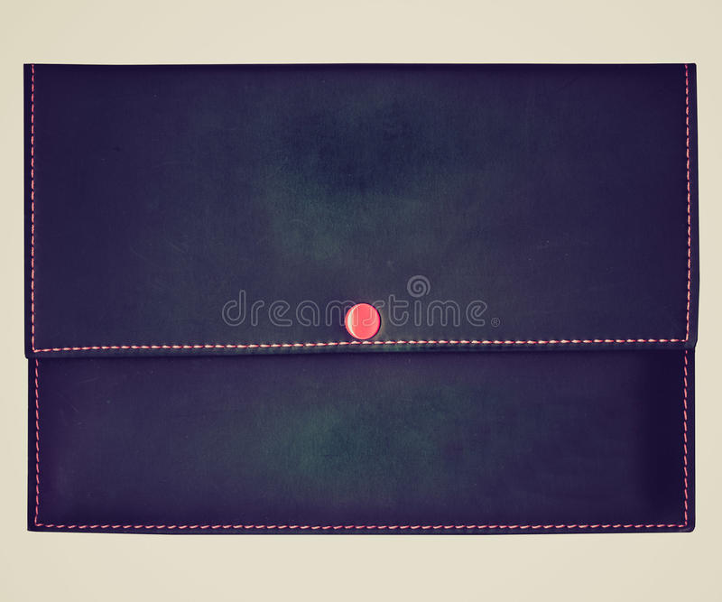 Retro look Wallet. Vintage looking Purse bag or wallet billfold, black over white background stock image