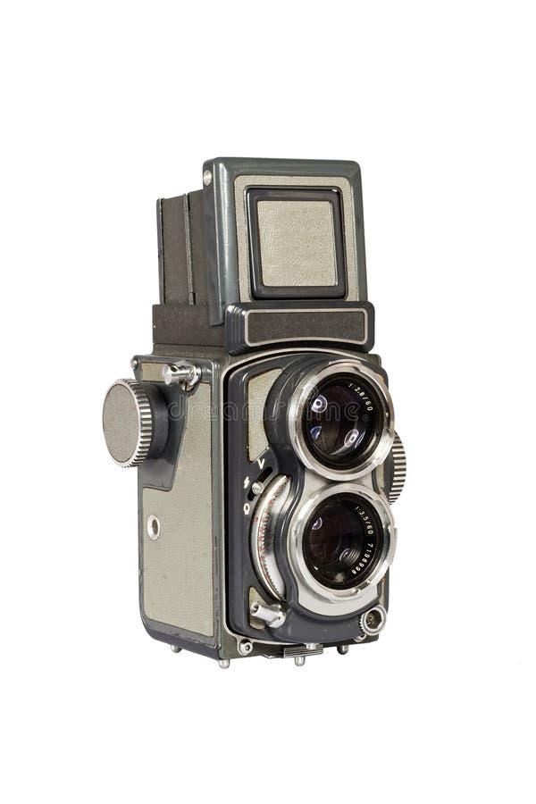 Retro macchina fotografica gemellare dell'obiettivo isolata su bianco immagine stock