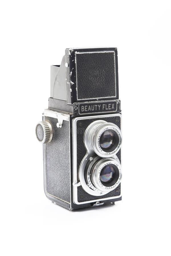 Retro macchina fotografica su bianco immagine stock