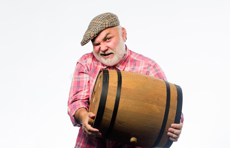 Retro man with a beer barrel. Barman. wooden barrel. oktoberfest festival. brewery for maturing alcohol. Homemade wine. Man bearded senior carry wooden barrel royalty free stock photography