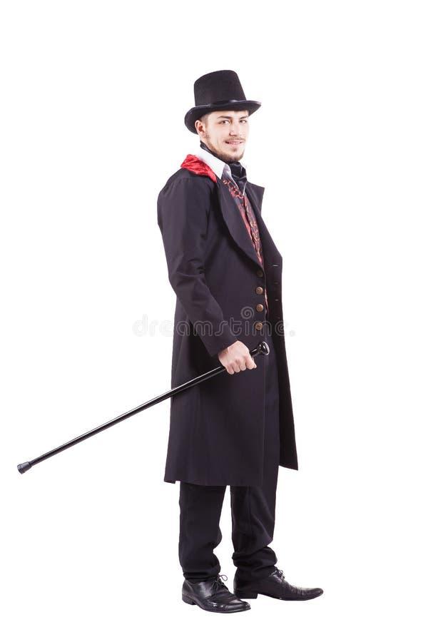 Retro maniermens met baard die zwart kostuum dragen stock foto's
