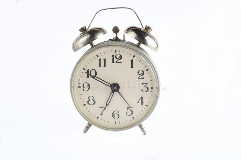 Retro metal alarm clock isolated on white. Morning time, time to get up. Retro metal alarm clock isolated on white. Morning time, time to get up stock photography