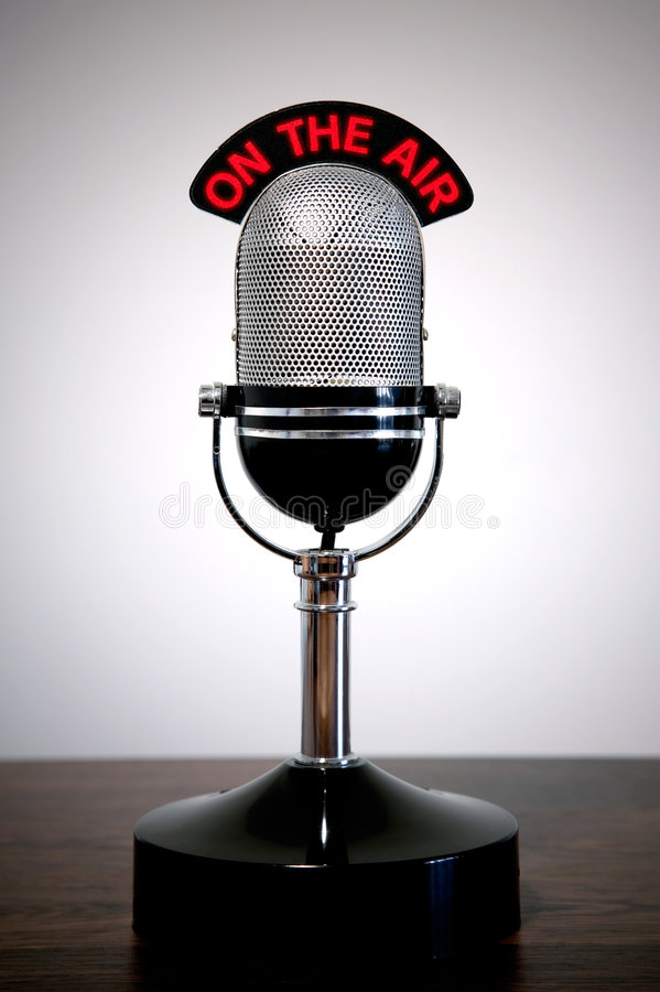 Retro microphone. With an 'On the Air' illuminated sign on a desk, vignetted background