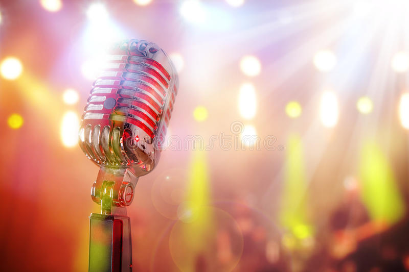 Retro microphone. Against colourful background royalty free stock photography