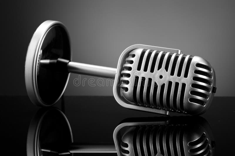 Retro microphone on grey stock photos