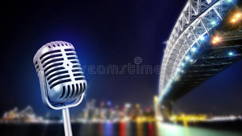 Retro microphone isolated on city lights. Placed on wooden table with tones royalty free stock image