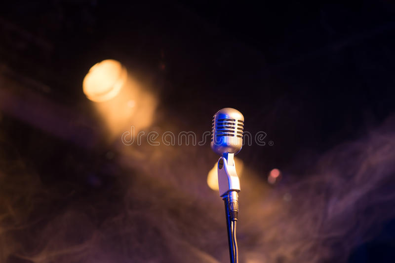 Retro microphone mic, professional equipment with light and smoke. Retro microphone mic, professional equipment stock photography