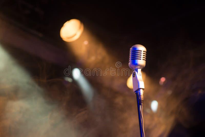 Retro microphone mic, professional equipment with light and smoke. Retro microphone mic, professional equipment royalty free stock photography