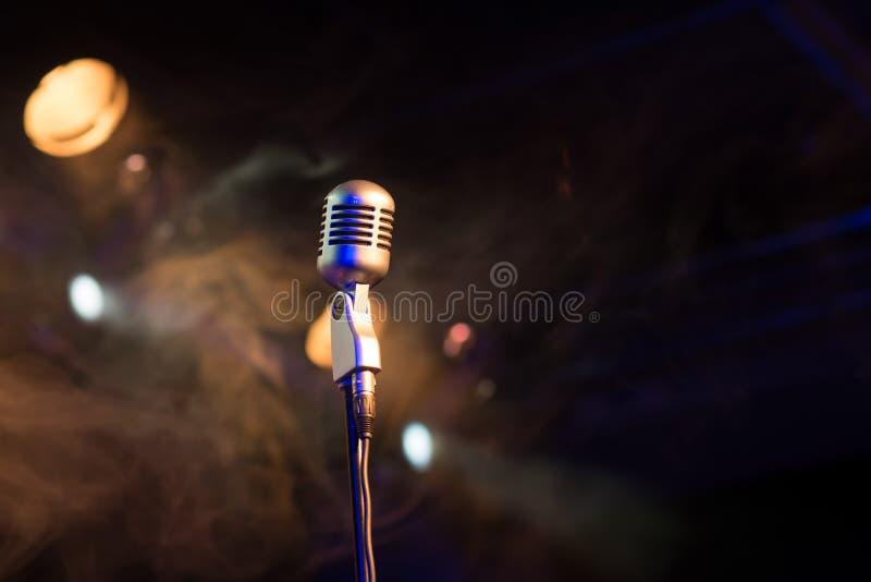 Retro microphone mic, professional equipment with light and smoke. Retro microphone mic, professional equipment royalty free stock photos