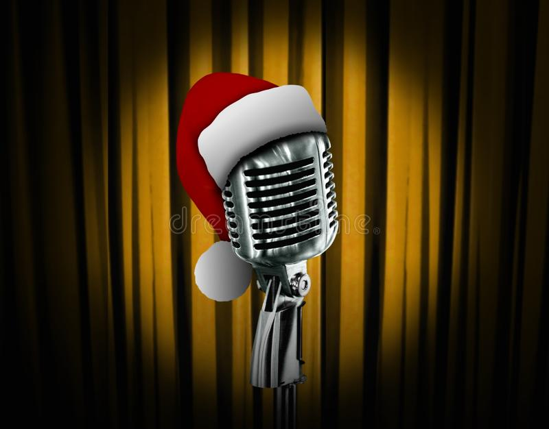 Retro microphone and red curtain. Retro microphone and Santa hat over curtain stock photos