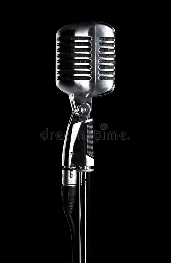Retro microphone on stand on black royalty free stock image