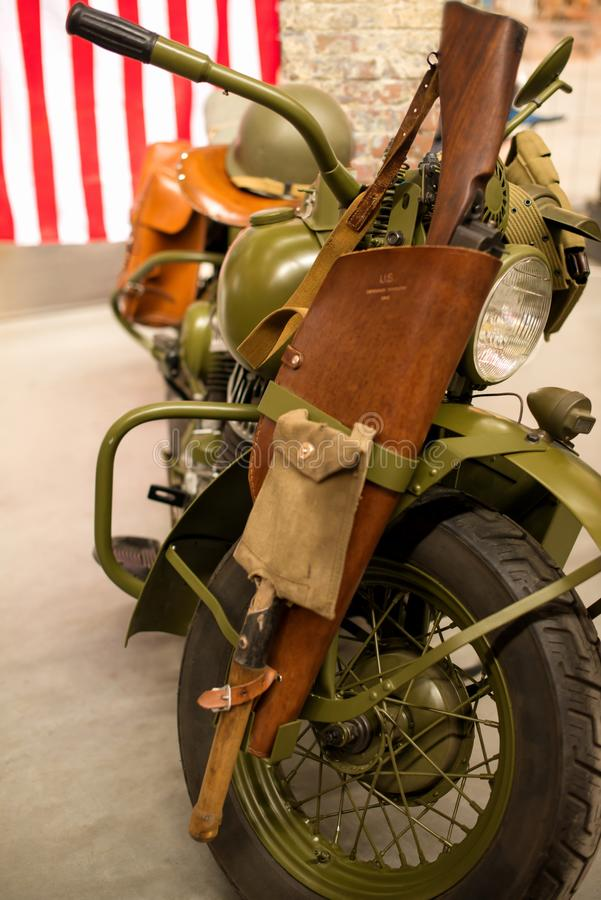 Retro military American motorcycle of protective color at the ex royalty free stock photos