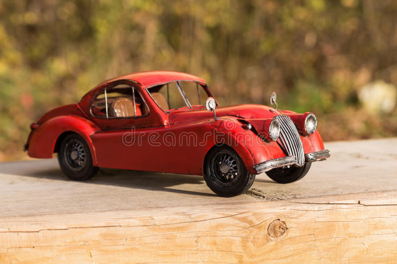 Retro model car in the garden. stock images
