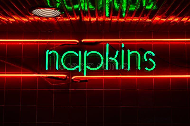 Retro Neon Napkins Restaurant Sign  on Tile royalty free stock photos