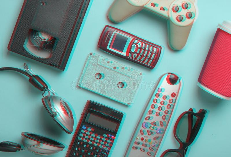 Glitch effect of Retro objects on blue background. 3d glasses, audio cassette, video cassette, gamepad,calculator royalty free stock photos