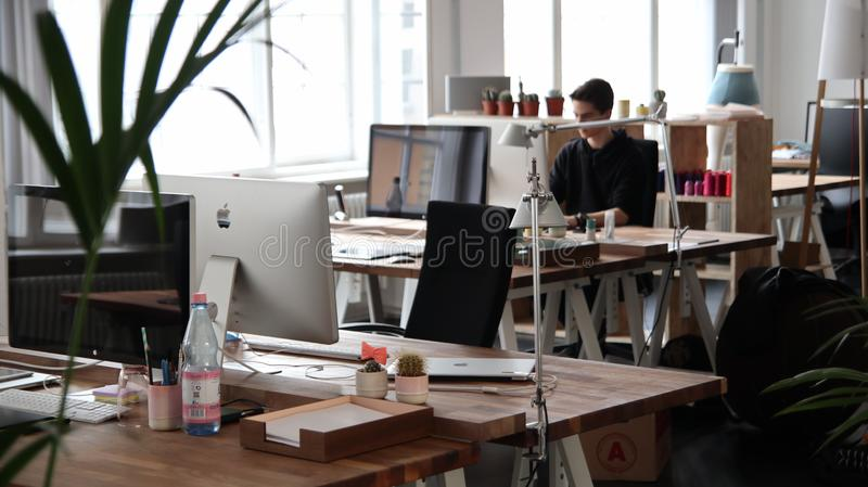 Retro office with tables and a plant stock photos