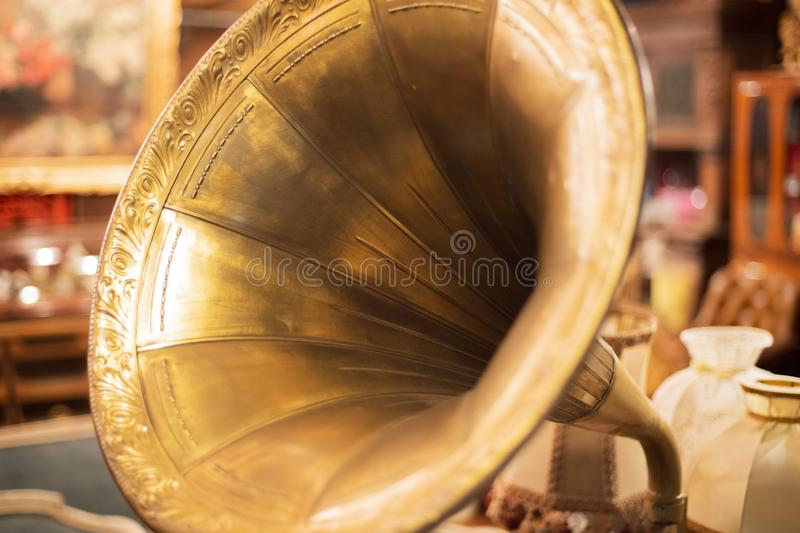 Retro old gramophone, ancient record player with a yellow pipe close up stock photos