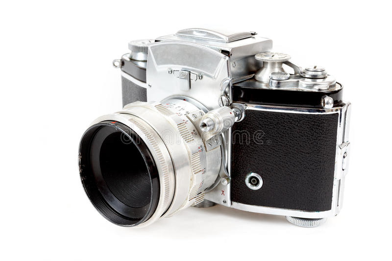 Retro old vintage analog photo camera on white. Background view from the side royalty free stock photography