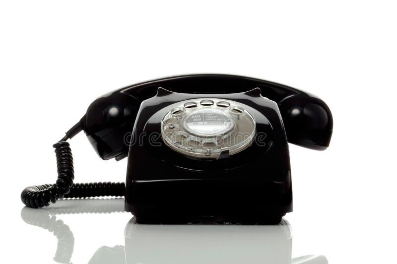 Retro oude zwarte telefoon royalty-vrije stock afbeeldingen
