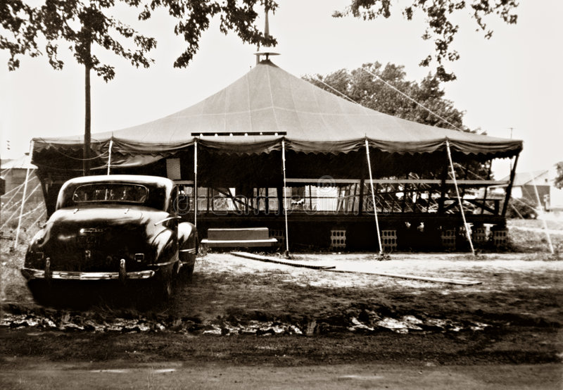 Retro Outdoor Skating Rink. Early 1950s outdoor roller skating rink with early model Nash car. Sepia-toned color image. Original photograph taken in the 1950s royalty free stock images