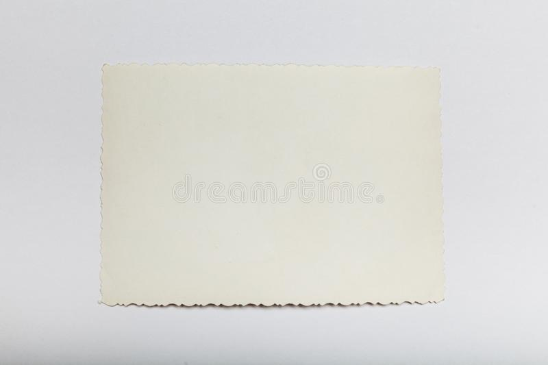 Retro paper photo, old picture card. Antique background. Copy space for text stock image