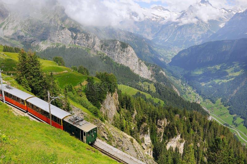 Retro passenger train. Retro passenger train moves from Schynige Platte to Interlaken. Switzerland stock photo