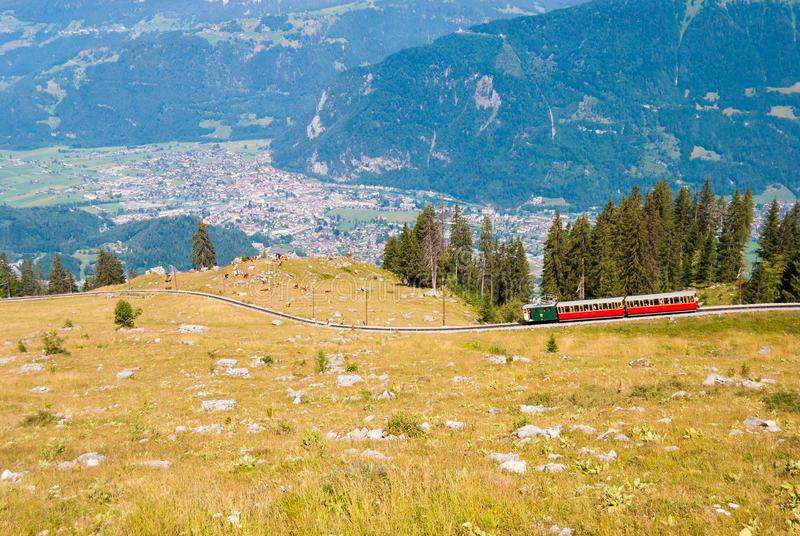 Retro passenger train moves from Schynige Platte to Interlaken. Switzerland. Retro passenger train moves from Schynige Platte to Interlaken Switzerland royalty free stock images
