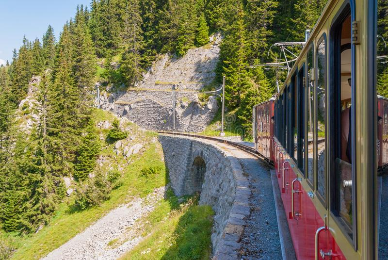 Retro passenger train moves from Schynige Platte to Interlaken. Switzerland. Retro passenger train moves from Schynige Platte to Interlaken Switzerland stock photo