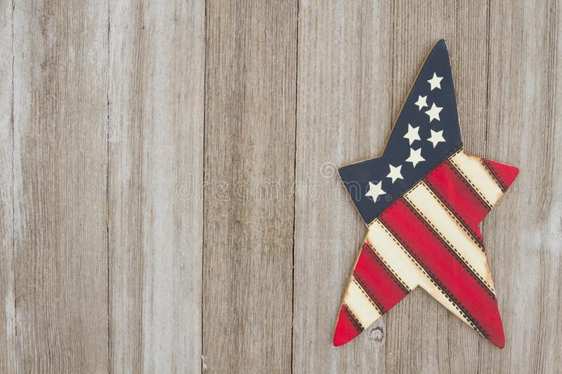 Retro patriotic USA background with American star. Retro patriotic USA background, USA patriotic old star on a weathered wood background with copy space royalty free stock photos