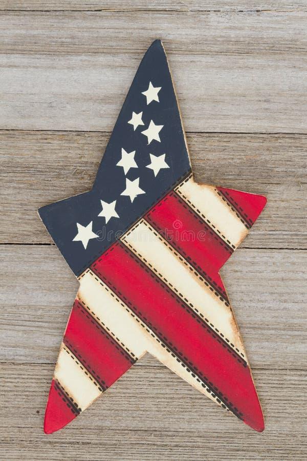 Retro patriotic USA symbol on wood. Retro patriotic USA background, USA patriotic old star on a weathered wood background royalty free stock photos