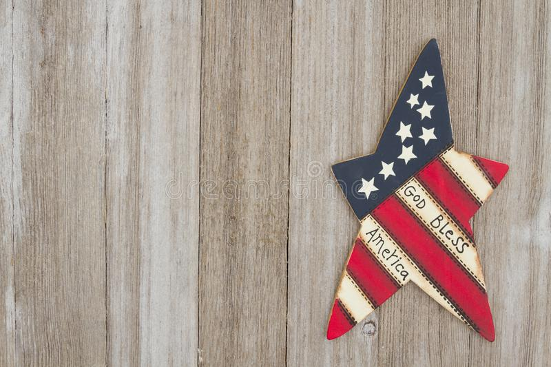 Retro patriotic USA background God Bless America. Retro patriotic USA background, USA patriotic old star on a weathered wood background with copy space royalty free stock image