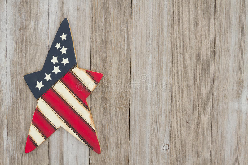 Retro patriotic USA background. USA patriotic old star on a weathered wood background with copy space stock photos