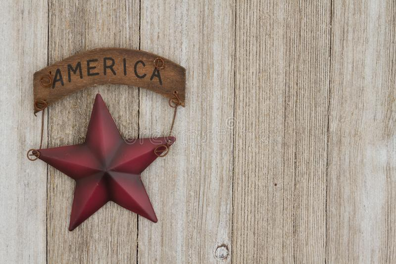Retro patriotic USA background on weathered wood. Retro patriotic USA background, USA patriotic old star on a weathered wood background with copy space stock photo