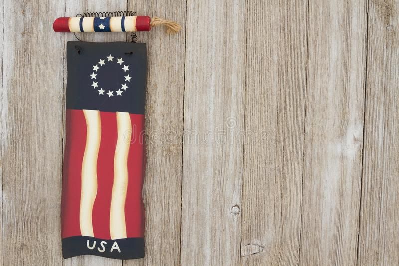 Retro patriotic USA background on weathered wood. Retro patriotic USA background, USA patriotic old flag on a weathered wood background with copy space royalty free stock images