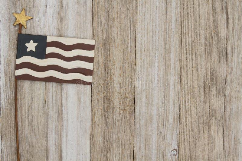 Retro patriotic USA background on weathered wood. Retro patriotic USA background, USA patriotic old metal flag on a weathered wood background with copy space stock photos